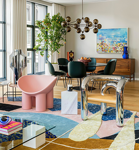 The colorful living and dining room in the Tribeca home of Elle Langston