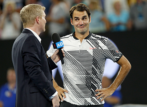 Roger Federer with Jim Courier at the 2017 Australian Open