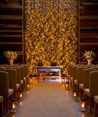 Set the mood for your big day with glowing configurations made of string lights, lanterns, chandeliers, and beyond
