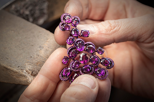 Titanium earrings set with rhodolites and pink sapphires