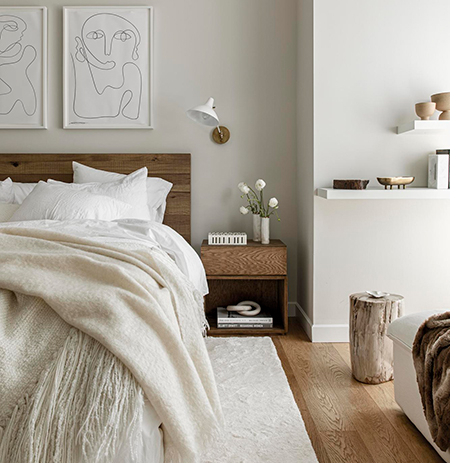A layered, calm bedroom in a SoHo apartment