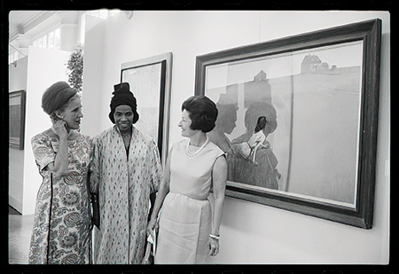 """Biographer Catherine Drinker Bowen, singer Marian Anderson and Lady Bird Johnson standing in front of Andrew Wyeth's """"Christina's World"""" at the White House Festival of the Arts, June 1965"""