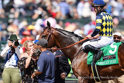 Jill Baffert, co-owner, gives Du Jour a kiss after his win in the G2 American Turf